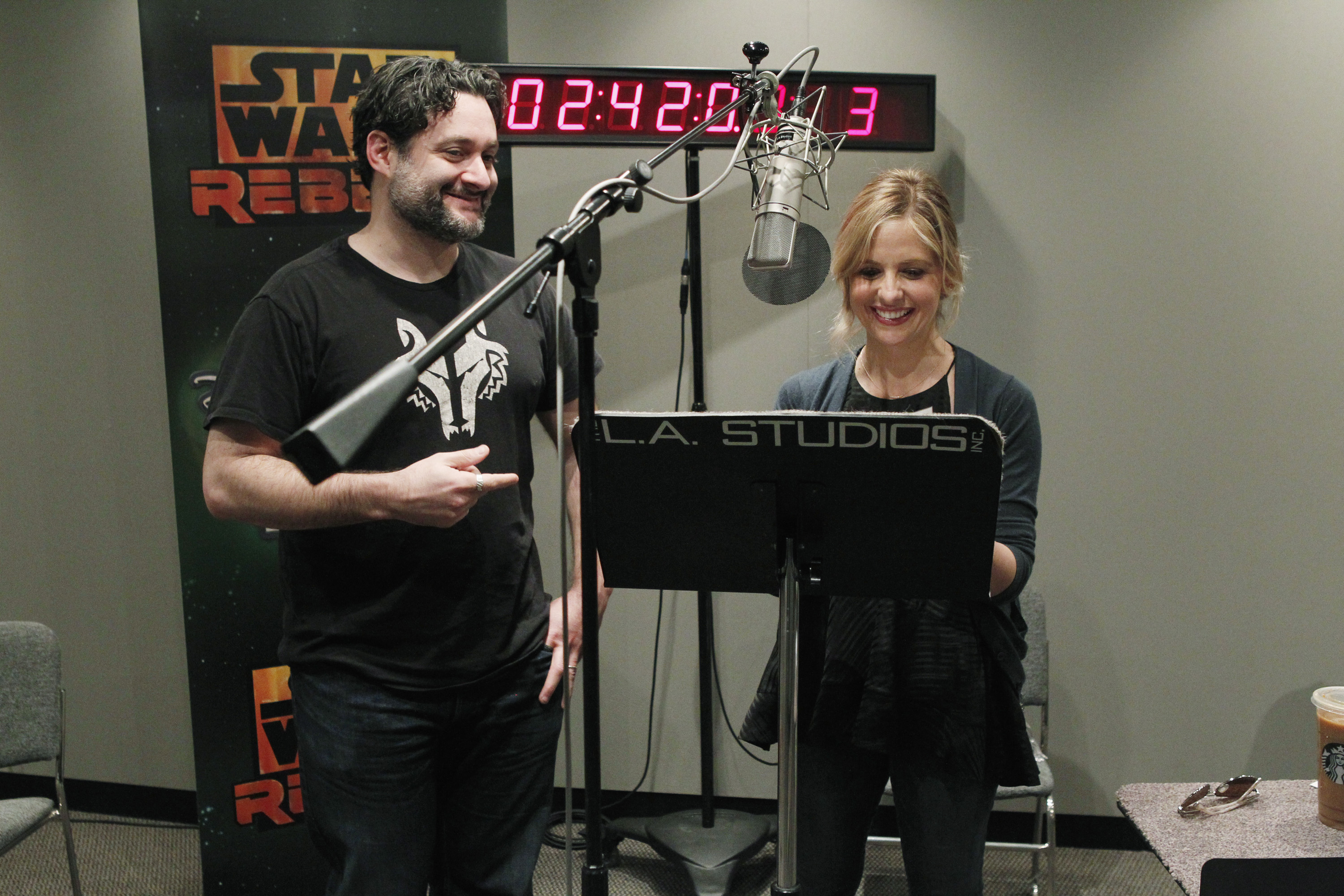 "Sarah Michelle Gellar and Executive Producer Dave Filoni during a ""Star Wars Rebels"" voice recording session"