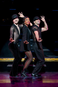 Brandy Norwood as Roxie Hart, with Denny Paschall (l.) and Michael Scirrotto (r.)